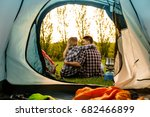 shot of a happy couple camping... | Shutterstock . vector #682466899