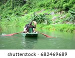people rowing on the river | Shutterstock . vector #682469689