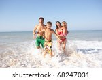 young family play on beach | Shutterstock . vector #68247031