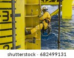 working at height. a commercial ... | Shutterstock . vector #682499131