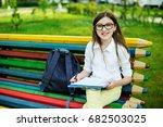 adorable young  schoolgirl  in... | Shutterstock . vector #682503025