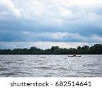 man in selfmade wooden kayak in ... | Shutterstock . vector #682514641