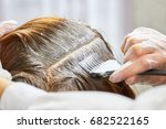 hair dying process close up.... | Shutterstock . vector #682522165
