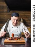 chef holding mouth watering... | Shutterstock . vector #682522261