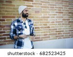 positive bearded guy dressed in