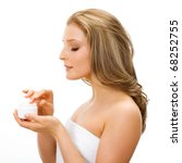 Young adult girl applying moisturiser cream. Healthcare concept. - stock photo