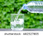 pour clean water in a glass of...   Shutterstock . vector #682527805