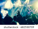 crowd with raised hands at... | Shutterstock . vector #682530709