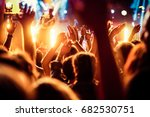 crowd with raised hands at... | Shutterstock . vector #682530751