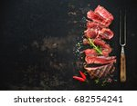 sliced medium rare grilled beef ... | Shutterstock . vector #682554241