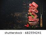 sliced medium rare grilled beef ... | Shutterstock . vector #682554241