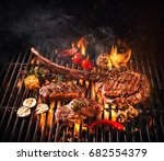 beef steaks on the grill with... | Shutterstock . vector #682554379