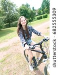 girl teenager on a bicycle | Shutterstock . vector #682555309