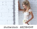 beautiful young bride in white... | Shutterstock . vector #682584349
