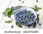 fresh ripe blueberries with... | Shutterstock . vector #682596385