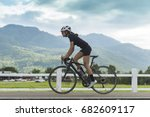 female cyclist cycling on... | Shutterstock . vector #682609117