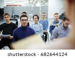 group of students listening to... | Shutterstock . vector #682644124