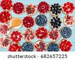 fruit and berry tartlets... | Shutterstock . vector #682657225