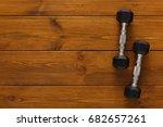 two dumbbells on wooden... | Shutterstock . vector #682657261