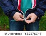 a man zips up a jacket. hands...   Shutterstock . vector #682676149