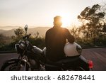 brutal young biker wears black... | Shutterstock . vector #682678441