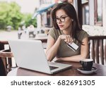 young woman holding credit card ... | Shutterstock . vector #682691305
