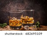 whiskey with ice in glasses on... | Shutterstock . vector #682695109