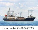 general cargo ship in the ocean | Shutterstock . vector #682697329