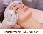 the doctor cosmetologist makes... | Shutterstock . vector #682701559