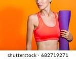 sporty girl holding yoga mat... | Shutterstock . vector #682719271