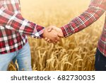 people shaking hands in a wheat ... | Shutterstock . vector #682730035