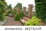 Benches In A Walled Garden Wit...