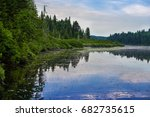 Small photo of Laurentian forest reflection in the lake