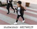 trendy little schoolgirl walks... | Shutterstock . vector #682768129