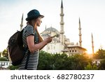 a young beautiful traveler girl ... | Shutterstock . vector #682780237
