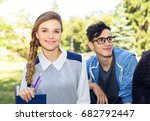 young woman student and friends. | Shutterstock . vector #682792447