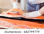 the chef cuts the salmon on the ... | Shutterstock . vector #682799779
