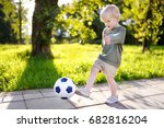 little boy having fun playing a ... | Shutterstock . vector #682816204