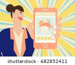 woman holding mobile phone with ...