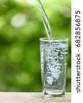 pouring fresh water into glass...   Shutterstock . vector #682856875