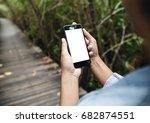 girl hold smart phone walking... | Shutterstock . vector #682874551