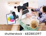female photographer sitting on... | Shutterstock . vector #682881097