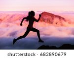 Small photo of Trail runner nature landscape running woman silhouette on mountains background in cold weather with pink clouds at sunset. Amazing scenic view of peaks in altitude.