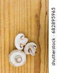 mushrooms on wooden cutting... | Shutterstock . vector #682895965