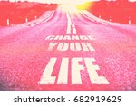 Small photo of Change your life written on road. Selective focus. Toned.