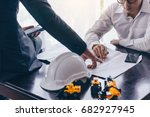 two engineers are consulting on ... | Shutterstock . vector #682927945