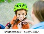 mother dresses her daughter's... | Shutterstock . vector #682936864