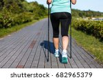 nordic walking   middle age... | Shutterstock . vector #682965379
