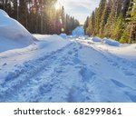 road in the forest. winter | Shutterstock . vector #682999861