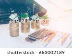 minature houses resting on...   Shutterstock . vector #683002189
